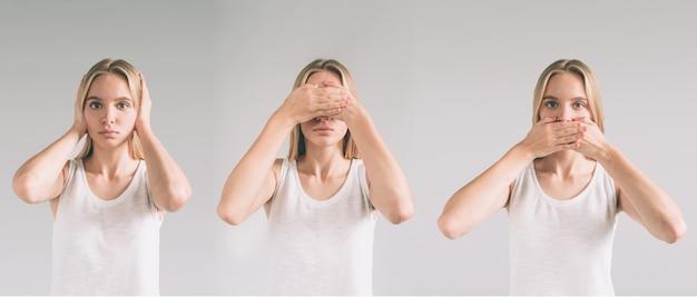 Blanke vrouw in de poses see no evil, hear no evil, speak no evil.