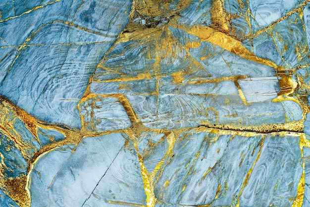 Blauw en goud geweven marmer