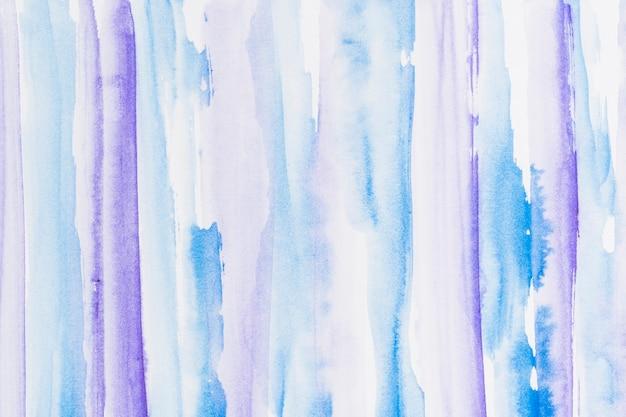 Blauw en paars geschilderde penseelstreek achtergrond