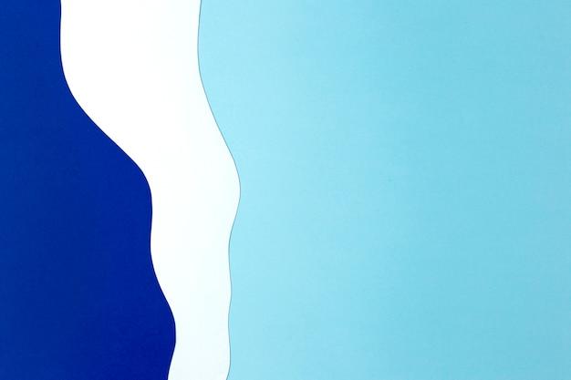 Blauw en wit papier achtergrondontwerp