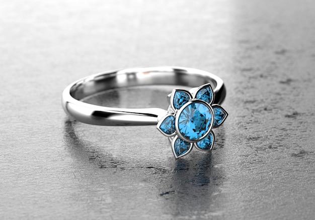 Blauw hart en ronde vorm diamond ring geplaatst op glanzende achtergrond