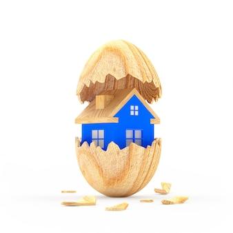 Blauw huis binnen een houten gebroken paasei