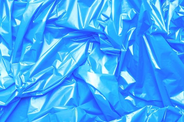 Blauw polyethyleen textuur oppervlak uitlaat cellofaan pakket