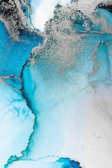 Blauw zilver abstracte achtergrond van marmeren vloeibare inkt kunst schilderij op papier.