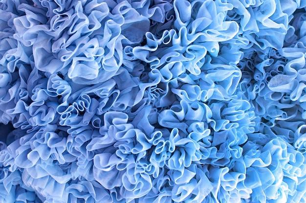 Blauwe abstracte kerstmisachtergrond volants