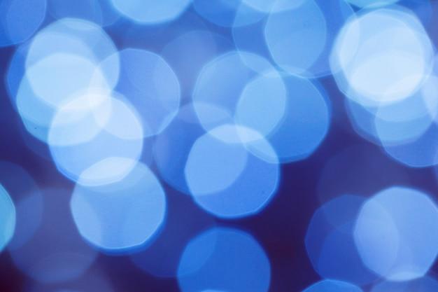 Blauwe abstracte lichten bokeh vage kerstmisachtergrond
