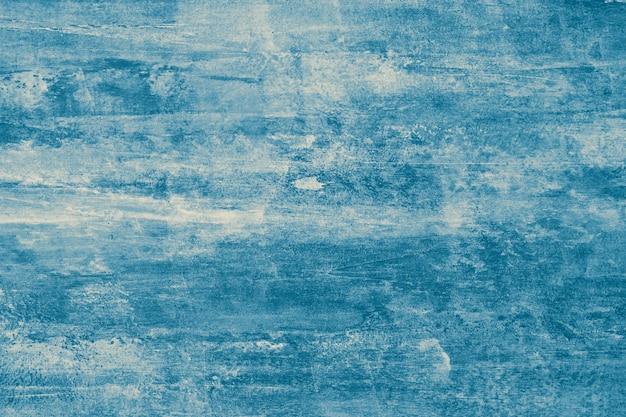 Blauwe abstracte textuur als achtergrond van waterverf. grunge geschilderde oppervlak, inktsjabloon met vlekken, vintage tekening, donkere aquarel.