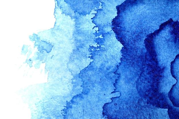 Blauwe aquarel abstracte achtergrond met vlekken