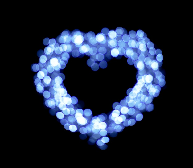 Blauwe bokeh hart vormen achtergrond.