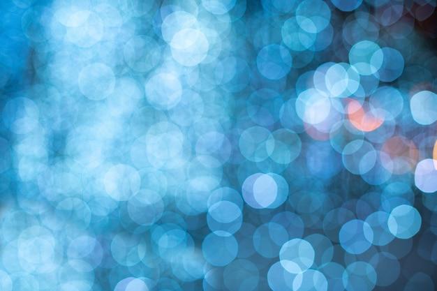 Blauwe bokeh vage lichtenachtergrond