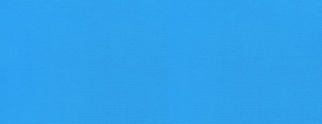 Blauwe canvas textuur banner als achtergrond. schoon stoffen behang