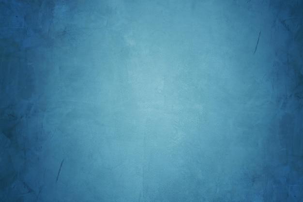 Blauwe cementmuur en grunge concrete behangachtergrond