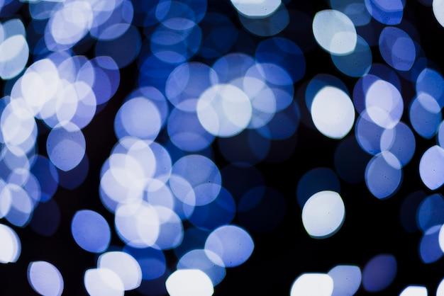 Blauwe cirkel neonlichtenachtergrond