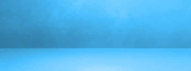 Blauwe concrete binnenlandse banner als achtergrond. lege sjabloonscène Premium Foto