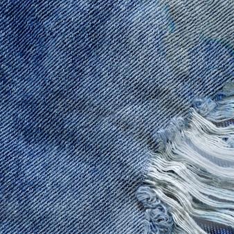 Blauwe de textuurachtergrond van denimjean. jeans gescheurde stoffentextuur Premium Foto