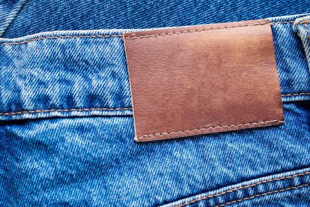 Blauwe denim jeans lederen label textuur achtergrond
