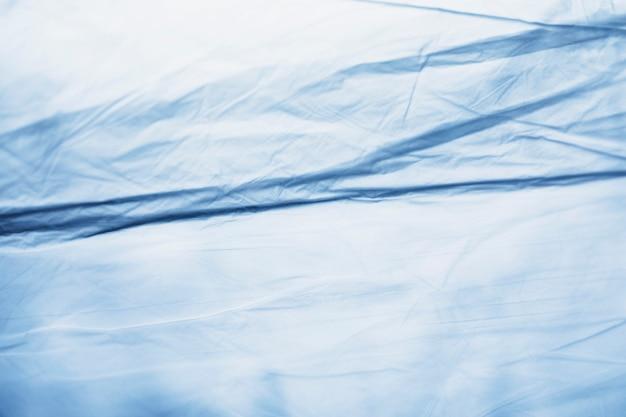Blauwe dichte omhooggaand van het plastic zakdetail