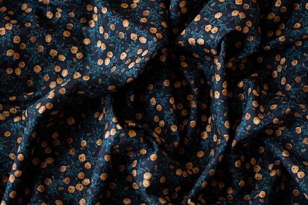Blauwe en gele bloemen stof achtergrond