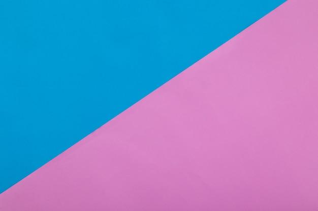 Blauwe en roze pastel papier textuur achtergrond, geometrische plat lag achtergrond.