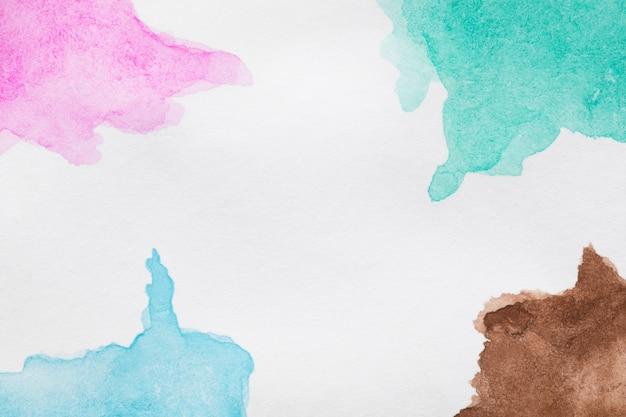 Blauwe en roze tinten handgeschilderde vlekken