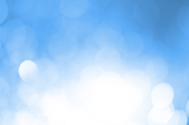 Blauwe en witte bokeh circulaire.