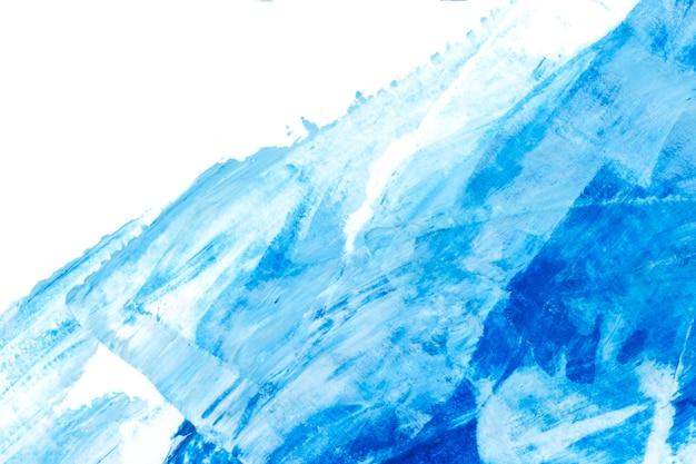 Blauwe en witte penseelstreek getextureerde achtergrond
