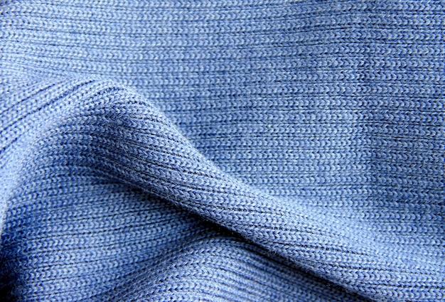 Blauwe gebreide wollen stof kan worden gebruikt als achtergrond en textuur