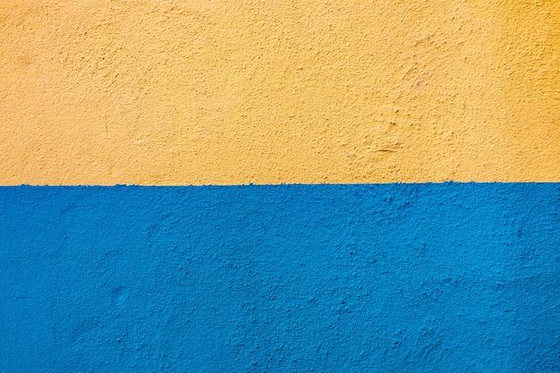 Blauwe gele muurachtergrond