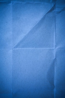 Blauwe gerecycled papier achtergrond.