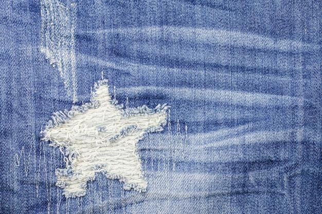 Blauwe gescheurde denim jeans textuur Premium Foto