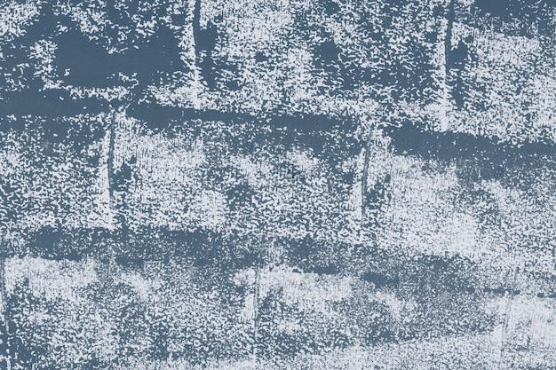 Blauwe getextureerde ruwe achtergrondblokafdrukken op stof