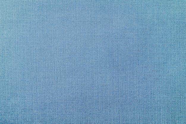 Blauwe geweven stoffenachtergrond