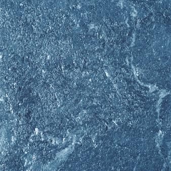Blauwe glanzende getextureerde papieren achtergrond Gratis Foto