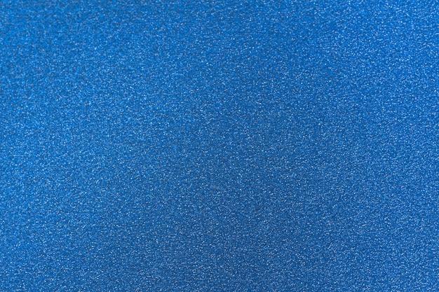 Blauwe glitter getextureerde glanzende achtergrond