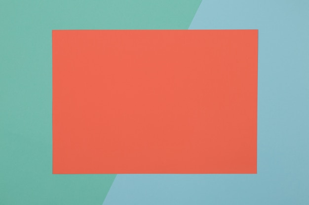 Blauwe, groene en oranje achtergrond, gekleurd papier verdeelt geometrisch in zones