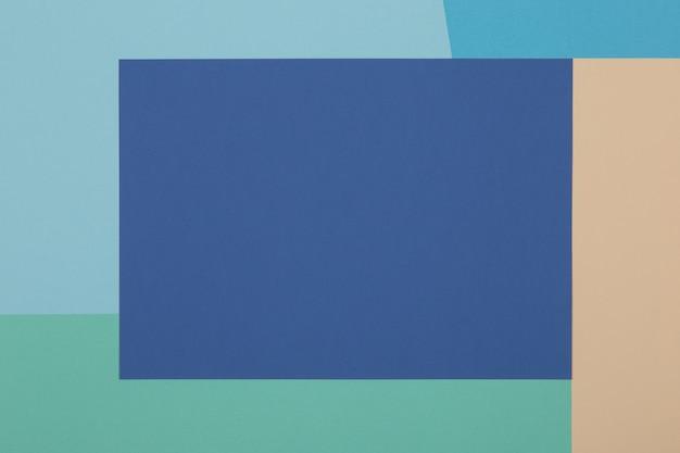 Blauwe, groene, gele achtergrond, gekleurd papier verdeelt geometrisch in zones