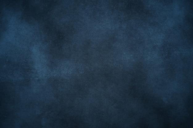 Blauwe grounge en misttextuur abstracte achtergrond met krassen en barsten met copyspace