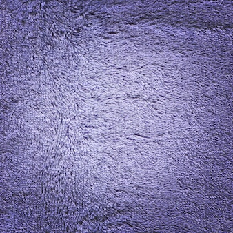 Blauwe handdoek oppervlaktetextuur achtergrond. ruwe blauwe handdoektextuur