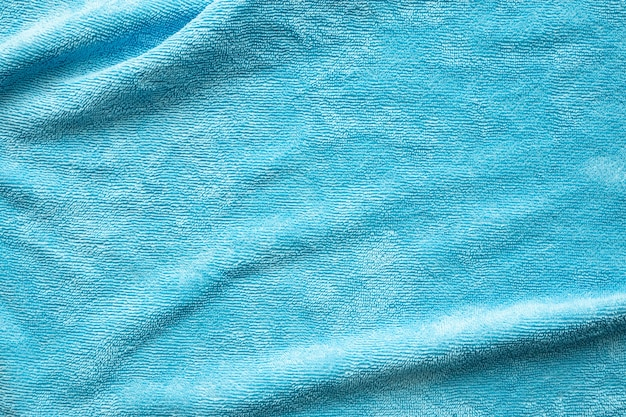 Blauwe handdoek stof textuur oppervlak close-up achtergrond
