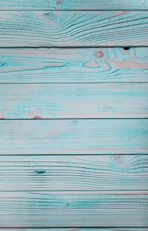 Blauwe houten muur, geschilderd in shabby chic stijl