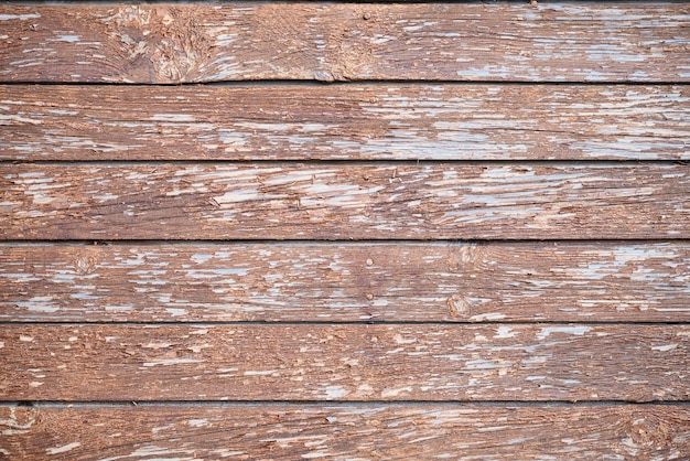 Blauwe houten textuur als achtergrond. achtergrond van oude planken. gebarsten verf.