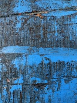Blauwe houten vuile plank