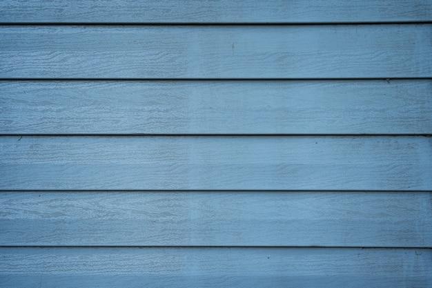 Blauwe houtstructuur van houten muur voor achtergrond en textuur.