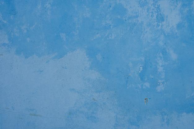 Blauwe ijzeren achtergrond met textuur. gelekte verf