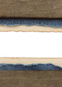 Blauwe jean en oud papier achtergrond
