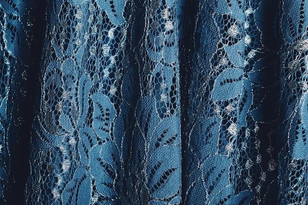 Blauwe kanten stof met bloemenpatroon
