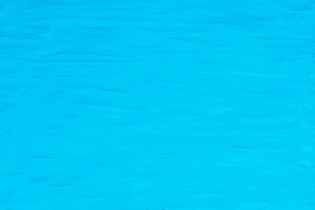 Blauwe klei getextureerde achtergrond kleurrijke handgemaakte creatieve kunst abstracte stijl