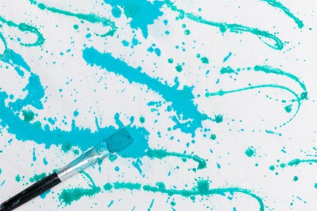 Blauwe kleur splash met penseel