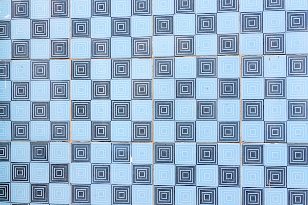 Blauwe mozaïek azulejo textuur in portugal. geometrische vormen en patronen.