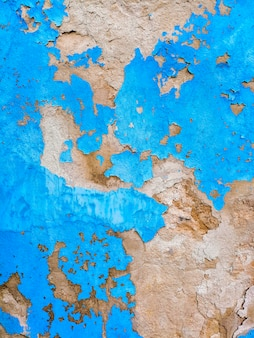 Blauwe muur met gebroken texturen